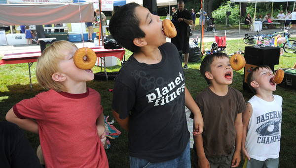 Merrimack: Contestants race to eat donuts at the donut eating contest at Old Home Days at the Donahue School in Merrimac. Jim Vaiknoras/staff photo
