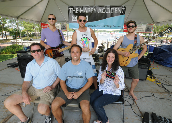 newburyport:Yankee Homecoming co-chairs Tim Burguss, Connie Salerno, and Chris Johnston pose with The Happy Accident, Chris Willhite, Bob Langlais, and Bill Kenney on Market Landing Stage. Jim Vaiknoras/staff photo