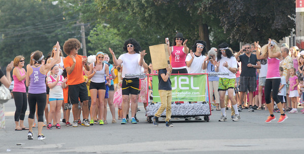 Newburyport: The Fuel Training Studio team strolls down Federal Street at the annual Yankee Homecoming Bed Race. Jim Vaiknoras/staff photo
