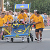 Newburyport: Pack 451 finshes the annual Yankee Homecoming Bed Race despite losing a wheel part-way through. Jim Vaiknoras/staff photo
