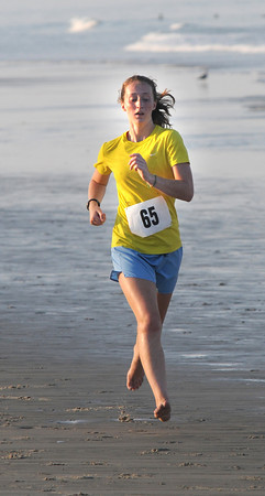 Salisbury: Molly Potter is the first woman finisher at the annual Salisbury Life Guard 5 mile run on Salisbury Beach . Jim Vaiknoras/staff photo