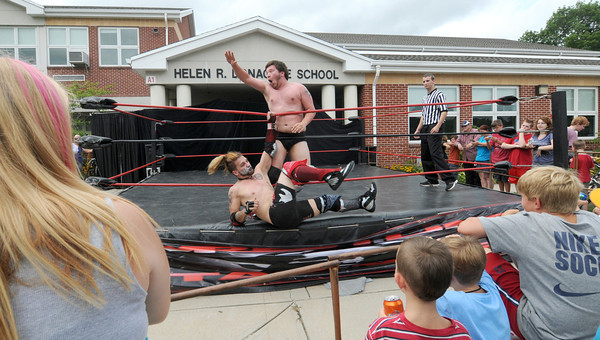 Merrimack: Star Wars Wrestling's Chris Cruise flips Alex Creed  at a wrestling match at Old Home Days at the Donahue School in Merrimac<br /> . Jim Vaiknoras/staff photo