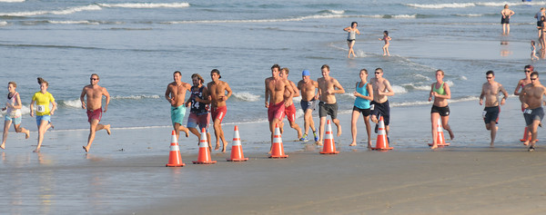 Salisbury: Runner take off at the start of the annual Salisbury Life Guard 5 mile run on Salisbury Beach . Jim Vaiknoras/staff photo