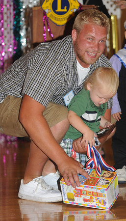 Seabrook: Matthew Michael Eagan get some help from his uncle Chris Thurlow in the Baby Seabrook Pageant at the Community Center Saturday. Jim Vaiknors/staff photo