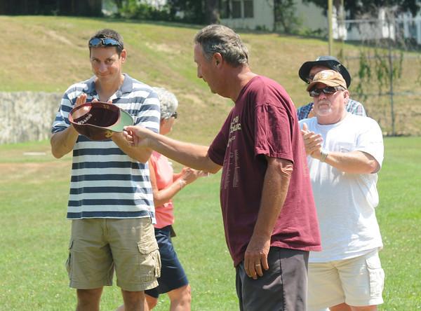 Newburyport: Bill Pettingell tips his hat at a dedication ceremony Saturday naming the Newburyport high lower field , Pettingell field. JIm Vaiknoras/staff photo