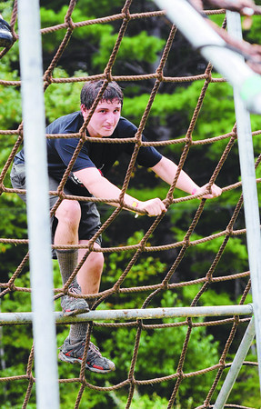 Amesbury: Eddie Talanian climbs a net ladder at the Spartan Race at Amesbury Sports Park climb over a large net during the race Saturday. Jim Vaiknoras/staff photo