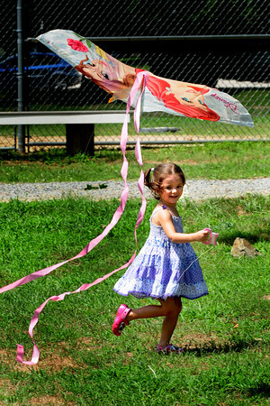 Amesbury: Isabella Burrell's kite gets ahead of her yesterday at Amesbury Town Park. The three year-old from Amesbury was there with her mother, Emi, on her first time kite-flying. Bryan Eaton/Staff Photo