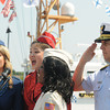 Newburyport: Coast Gurd Admiral Dan Abel salutes as the USO Liberty Bells perform the Star Spangles Banner at the ceremony Saturday on the waterfront naming Newburyport a Coast Guard City. Jim Vaiknoras/staff photo