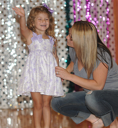 Seabrook: Kenndey Shea Daneau waves to the crowd with her mom Andrea Eaton in the Baby Seabrook Pageant at the Community Center Saturday. Jim Vaiknors/staff photo