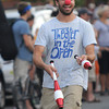Newburyport: Teddy Speck of Theater in the Open juggles his way to the finish  at the annual Yankee Homecoming Bed Race. Jim Vaiknoras/staff photo
