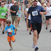 Newburyport: Tom Salemi sprint to the finish line with his son Theo after the 5k Tuesday night at the annual Lions Club Race. Jim Vaiknoras/staff photo