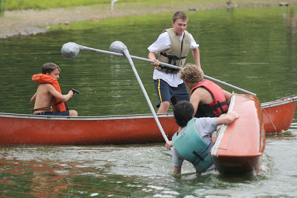 Newburyport: Brothers George and Chase Pantelis defeat Nick Walsh and Ian Cummings in the preliminaries in the canoe tilt at Old-Fashioned Sunday on the Bartlet Mall In Newburyport.The Pantelis brothers went on to win the event. Jim Vaiknoras/Staff photo