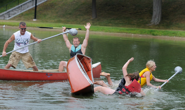 Newburyport: Brothers Ron and Eric Leaver celebrate their victory over Maureen Moore and Claire Cavanaugh in the canoe tilt at Old-Fashioned Sunday on the Bartlet Mall In Newburyport.The Leavers lost in the finals. Jim Vaiknoras/Staff photo