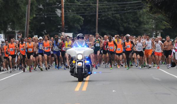 Newburyport: The Yankee Homecoming 10 mile race starts on High Street Tuesday night. JIm Vaiknoras/staff photo