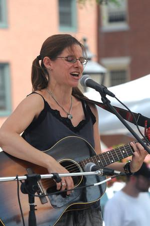 Newburyport: Susan Levine plays in Market Square Friday afternoon. JIm Vaiknoras/staff photo