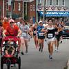 Newburyport: Runners from the Yankee Homecoming 5K race head along Water Street. Bryan Eaton/Staff Photo