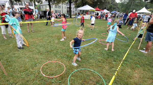 Newburyport: Kids play with Hula-Hoops at Old-Fashioned Sunday on the Bartlet Mall In Newburyport. Jim Vaiknoras/Staff photo