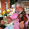Newburyport: John Tercyak plays the fiddle on State Street in Newburyport for browsers to the Market Square Craft Day Show. He was selling his recordings of music aimed to young children. Bryan Eaton/Staff Photo