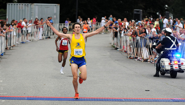 Newburyport: 10 mile winner Daniel Hocking throws up his hands in victory after crossing the finish line just infront of 2nd place finisher Dereje Hailegioruis Tuesday night at the annual Lions Club Race. Jim Vaiknoras/staff photo