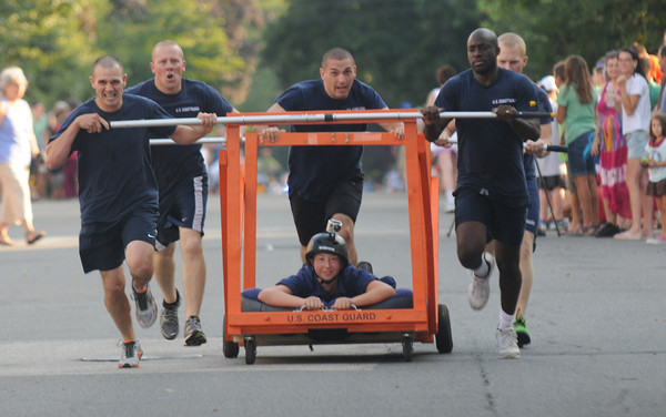 Newburyport: The Coast Guard bed is the fastest at the annual Yankee Homecoming Bed Race. Jim Vaiknoras/Staff photo
