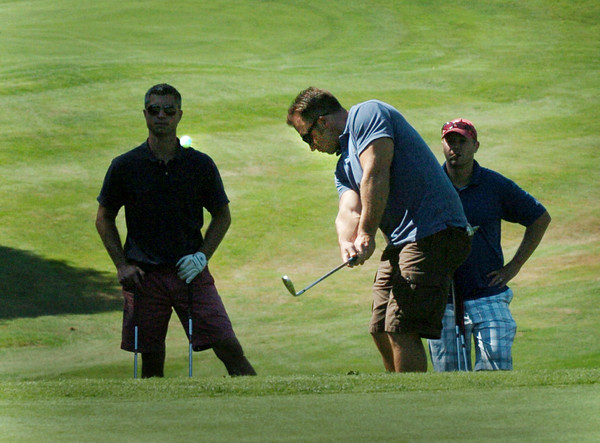 Newbury: Ryan Grindrod of Providence, visitin friends here, hits the ball to the ninth hole in the Yankee Homecoming Golf Tournament at Ould Newbury Country Club. Bryan Eaton/Staff Photo