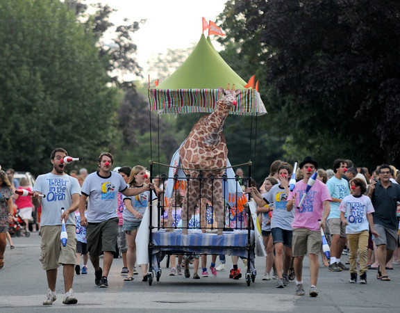 Newburyport: The Theater in the Open juggles their way to the finish with a big giraffe at the annual Yankee Homecoming Bed Race. Jim Vaiknoras/staff photo