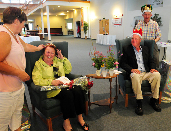 Newburyport: Peg McClure, seated left, and Paul Kolman were coronated Yankee Homecoming King and Queen by last year's honorees Kathy Eaton and Duncan MacBurnie. Bryan Eaton/Staff Photo