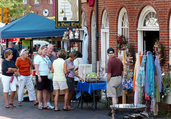 Newburyport: Shoppers check out items during Old-Fashioned Sidewalk Sales in Newburyport's Market Square. Bryan Eaton/Staff Photo