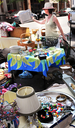 Newburyport: Ellen Sullivan Taylor of Amesbury checks out a serving tray at Flukes & Friends & Finds during Old-Fashioned Sidewalk Sales. Bryan Eaton/Staff Photo