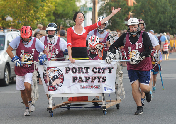 Newburyport: The Port City Paddys over 40 Lacrosse team race to the finish at the annual Yankee Homecoming Bed Race. Jim Vaiknoras/staff photo
