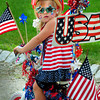 Newburyport: Justina Bucknill, 3, of Newbury had a very patriotic theme in the Bicycle and Carriage Parade at Kids Day in the Park. Bryan Eaton/Staff Photo