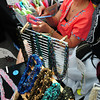 Newburyport: Eileen Gross of Kennebunk, Maine creates ribbon scarf wear, shown in foreground, at the Market Square Day Craft Show. Bryan Eaton/Staff Photo