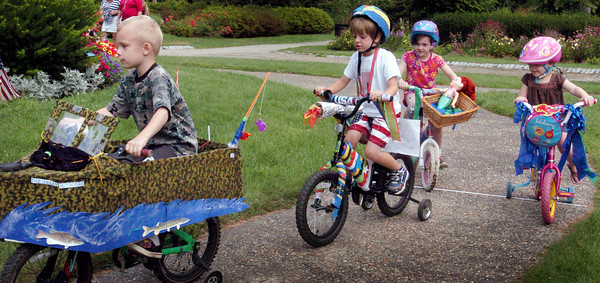 Newburyport: The Bicycle Parade gets underway yesterday morning at Yankee Homecoming's Kids Day in the Park at Atkinson Common. Bryan Eaton/Staff Photo