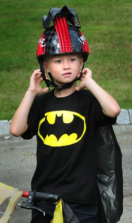 Newburyport: Adam Santosuosso, 6, of South Hampton adjusts his helmet dressed as batman for the bicyle parade. Bryan Eaton/Staff Photo