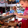 Newburyport: Ethan Evans, 6, of Fort Worth, Texas and visiting his grandparents who live in the area, checks out an alligator head at Sunburst booth during Yankee Homecoming's Old-Fashioned Sidewalk Sales. Bryan Eaton/Staff Photo