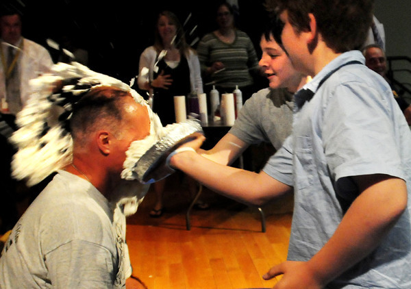 "Amesbury: Amesbury Middle School Principal Mike Curry gets a double pie in the face from students Troy Marden, center, 10, and Colin MacDonald, 11. The ""Pie a Teacher"" was a fundraiser to raise money for various military organizations. Bryan Eaton/Staff Photo"