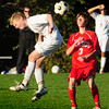 Newburyport: Newburyport's Jordan Steelman tries to head the ball away from Masconomet's Max Craig. Bryan Eaton/Staff Photo