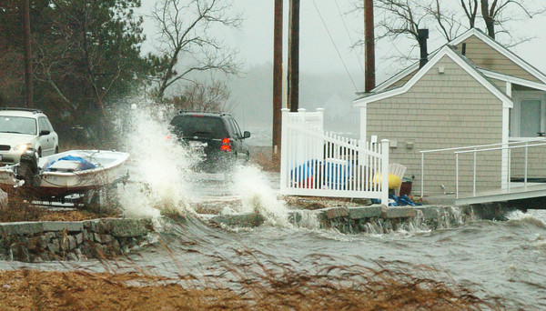Newburyport: An astronomical high tide with strong winds blew waves from the Merrimack River at Water Street in Newburyport onto the roadway yesterday afternoon. The weekend calms down but temperatures also drop for daytime highs into the 20's. Bryan Eaton/Staff Photo<br /> &#x0E;, Newburyport: An astronomical high tide with strong winds blew waves from the Merrimack River at Water Street in Newburyport onto the roadway yesterday afternoon. The weekend calms down but temperatures also drop for daytime highs into the 20's. Bryan Eaton/Staff Photo<br /> &#x0E;