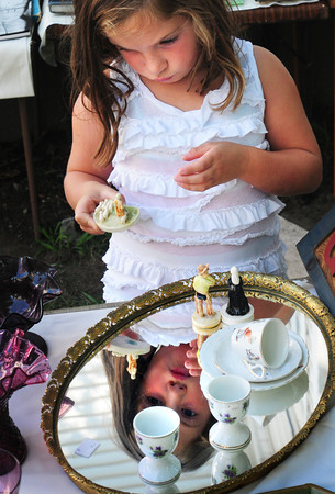 "Newburyport: After spending time with adults looking at what interests them at the 48th Annual Antiques School, Ella Santos, 5, of Newburyport said she wanted to ""look at the cute stuff."" Bryan Eaton/Staff Photo"