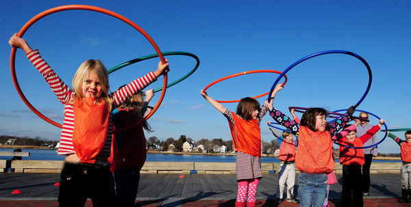 Newburyport: Kindergartners from the Newburyport Montessori School excercise with hula hoops yesterday afternoon on the Newburyport Waterfront along the boardwalk in gym class. Bryan Eaton/Staff Photo<br /> , Newburyport: Kindergartners from the Newburyport Montessori School excercise with hula hoops yesterday afternoon on the Newburyport Waterfront along the boardwalk in gym class. Bryan Eaton/Staff Photo