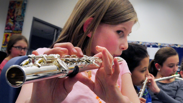 Salisbury: Mackenzi Kimball, 9, moves her fingers playing the flute to My Country 'Tis of Thee at Salisbury Elementary School on Thursday. She was in the afterschool program Beginner's Band taught by music teacher Deb Walton. Bryan Eaton/Staff Photo<br /> , Salisbury: Mackenzi Kimball, 9, moves her fingers playing the flute to My Country 'Tis of Thee at Salisbury Elementary School on Thursday. She was in the afterschool program Beginner's Band taught by music teacher Deb Walton. Bryan Eaton/Staff Photo