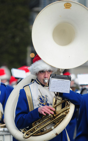 Merrimac: Owen Ricker plays sousaphone with the Georgetown Band in the annual Merrimac Santa Parade Sunday. JIm Vaiknoras/staff photo