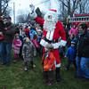 Newbury:Santa arrives  at the annual Tree Lighting on the Upper Green in Newbury Sunday night. Jim Vaiknoras/staff photo