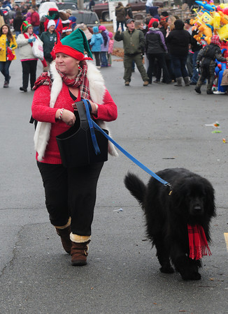 Merrimac: Lisa Varone and Mia give out candy in the annual Merrimac Santa Parade Sunday. JIm Vaiknoras/staff photo