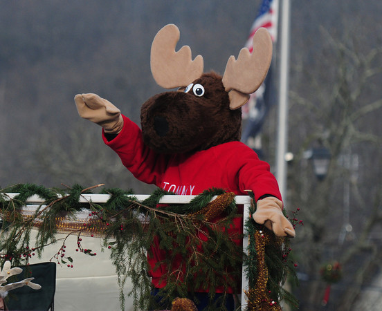 Merrimac: Tommy the Moose of Moose Lodge 1601 wishes everyone a Merry Christmoose during the annual Merrimac Santa Parade sunday. Jim Vaiknoras/staff photo