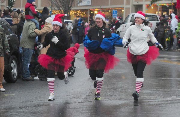 Amesbury: A trio of women get into the holiday spirit as they make their way though Market Square in Amesbury in The 2nd Annual Run Santa Run 1-Miler Saturday. Jim Vaiknoras/staff photo