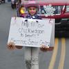 Merrimac: Jillian Marden helps collect money for the Merrimac Senior Center during the annual Merrimac Santa Parade Sunday. JIm Vaiknoras/staff photo