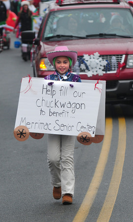 Merrimac: Jillian Marden helps collect money for the Merrimac Senior Center during the annual Merrimac Santa Parade Sunday. JIm Vaiknoras/staff photo