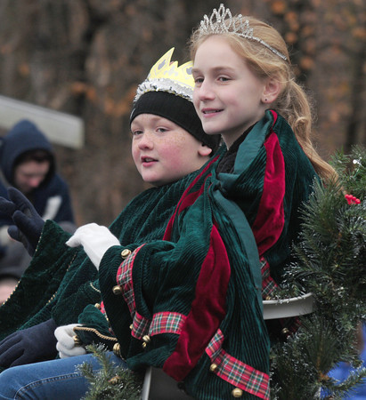 Merrimac: Parade King and Queen Danny Oteri and Lauren DeBoyes make their way up Church Street in the annual Merrimac Santa Parade Sunday. JIm Vaiknoras/staff photo