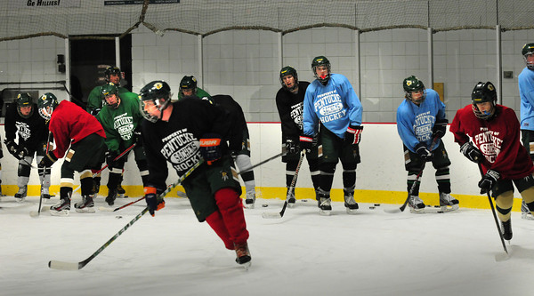 Haverhill: Pentucket High hockey seniors and their lower classmates practice at the Haverhill Rink on Tuesday. Bryan Eaton/Staff Photo